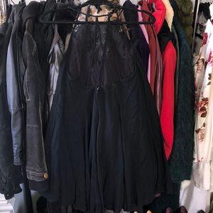 Lush little black flowy strappy backless dress